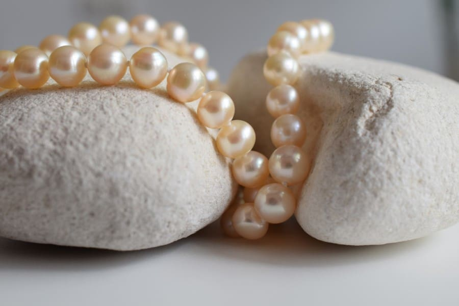 Pearls Necklace on White Rocks