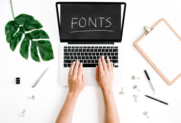 """Person typing on computer """"fonts"""""""