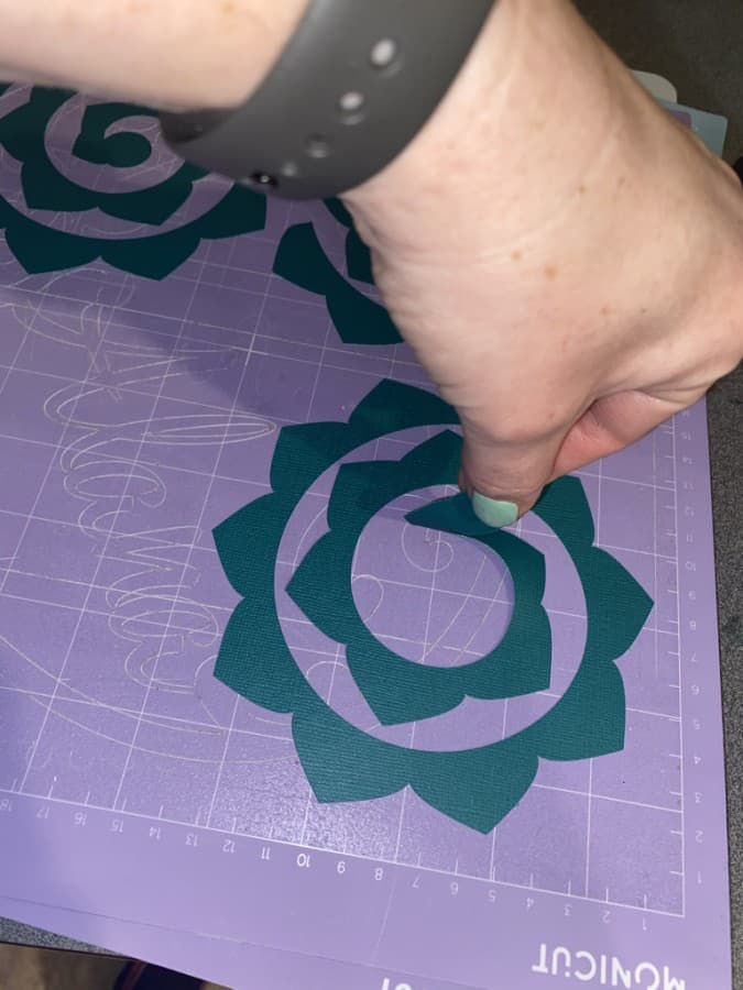 image of removing paper flower from sticky mat