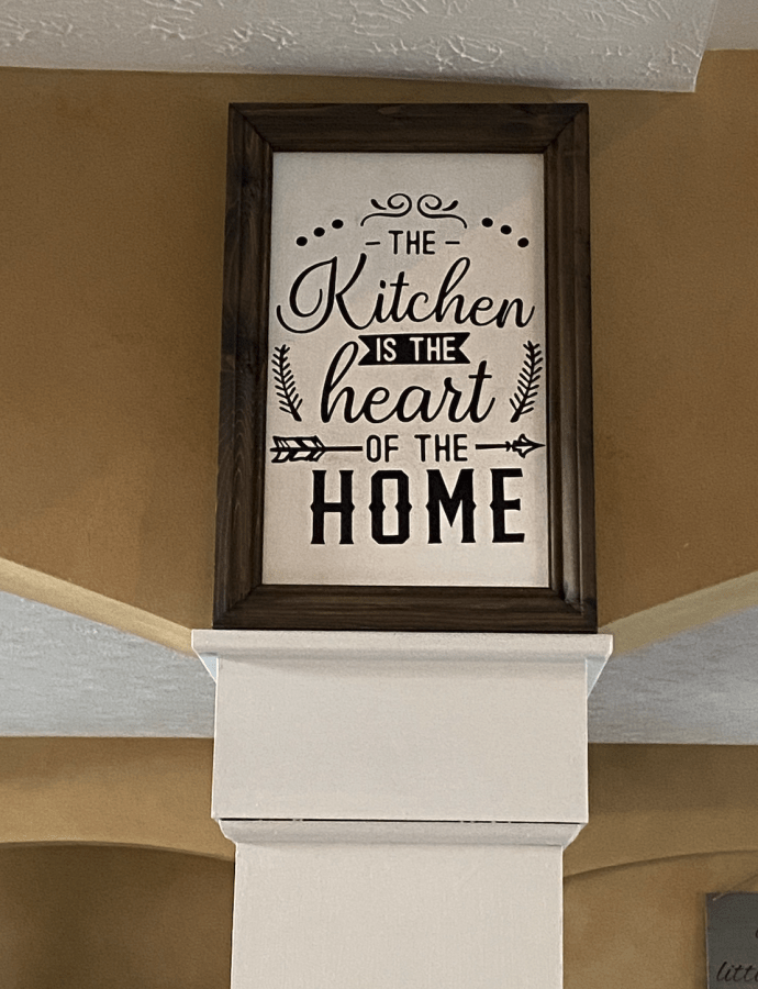 The kitchen is the heart of the home sign